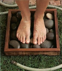 Place to wash off your feet before entering the house -- A box with river stones near the hose