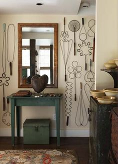 """Rug beaters as wall art!  I really love this.  """"...creative display of various rug beaters en masse acts like wallpaper, creating a fantastic graphic. Whoever thought rug beaters could be so interesting!"""""""