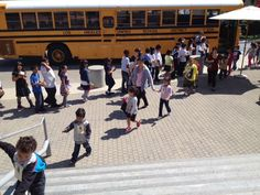 Bring on the Buses! Happy kids arriving for a field trip.