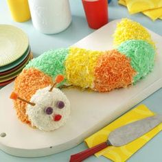 """This colorful creeping catepillar is easy to make with a boxed cake mix and prepared frosting,"""" assures Lee Dean of Boaz, Alabama. To save a step, tint the frosting and omit the coconut.  0"""