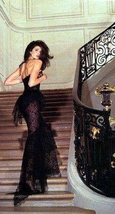 Chanel... I just can't decide what I like more, the dress or the spectacular wrought iron staircase?