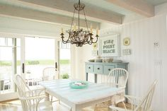Coastal House by Tracey Rapisardi Design - blue and white beachy dining room
