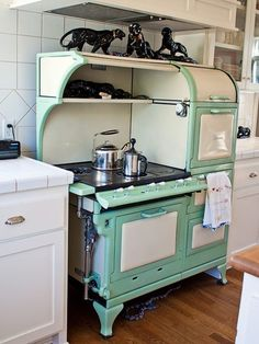 vintage stove with cats on top even!