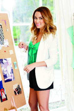 White blazer, green bow top, and shorts