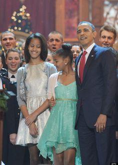 Malia  and Sasha Obama w/ their dad