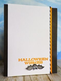handmade Halloween card from stamping and stitching .... clean and simple ... mostly white ... like the line of baker's twine in the grouped vertical lines ... adorable bat colored, punched out and hung upside down under the sentiment ... great card!