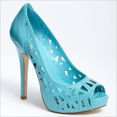 Pair these bright, baby blue  pumps with a flirty, floral mini dress and cute shirt for a look that screams breezy summertime perfection. They feature scattered cutout detail, a pretty peep-toe, leather upper and a slim, 4-inch heel. Perfect for day or night, you can literally wear these shoes anywhere.