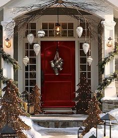 Christmas Front Door Decor - like the use of giant ornaments here