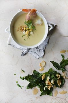 // Smoked Corn, Coconut, and Shrimp soup with crispy chard and garlic salad