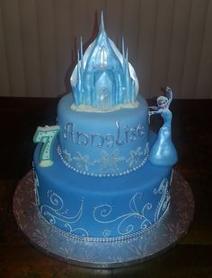 Frozen Cake with Elsa - Cakes are covered in fondant.  Castle is gumpaste.  Elsa is gumpaste for the dress and a paper cut-out for the body.  My daughter actually wanted a figurine so that she could play with it afterwards, but every place I checked was sold out.  So I had to improvise!