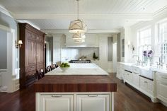 White kitchen with two apron front sinks, marble countertop & wood block countertop   Yunker Assoc Architecture