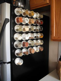 Spices with magnets are placed on fridge