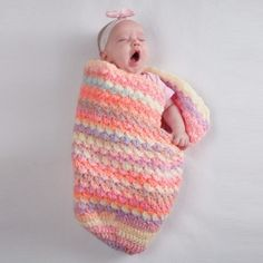 Crochet these 2 quick and easy cocoons. They are perfect for nursing or cuddling with your baby.