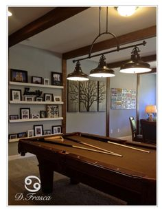 See the lighting fixture over the pool table? Trend alert! It's industrial and fabulous! @Meritage Homes    incorporated beautiful #lighting  in their model homes. Would you want this #ManCave in your home?  http://wp.me/pK9I2-12t