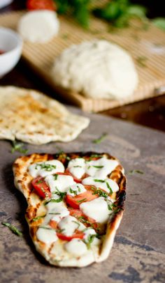 Grilled Garlic Naan Pizzas.  I usually use spaghetti sauce, goat cheese, and chicken, with more cheese and mushrooms.