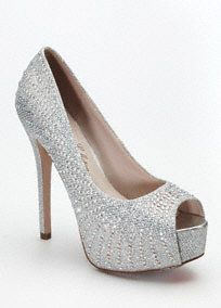 """Spice up your look with these glitzy high heel platformpeep toe pumps!  Features all over flatback crystals that are perfect for lighting up the night.  Available in Champagne Metallic and Silver Metallic.  Heel height: 5"""". Platform height: 1.5"""".  Imported."""