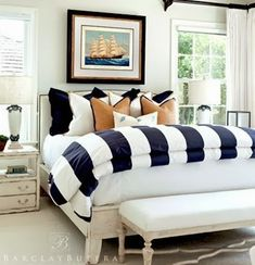 Everything Coastal....: Time for a Coastal Bedroom Redo. How about a Nautical Theme? wide navy and white stripes! cheery