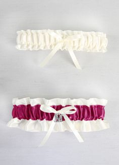 A single initial letter charm is the perfect way to personalize your bridal garter.   Features and Facts:  Measures 12.5 inches around unstretched  Available in a variety of David's Bridal Exclusive Colors  Personalize with your Last Name Initial!