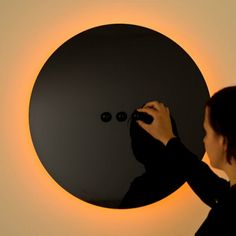 Specialising in the design and production of bespoke lighting, Australian design studio ilanel, have created ORA – an eclipse-like interactive and contemporary wall-mounted luminary with a minimal aesthetic finish.