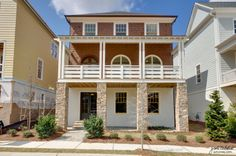 Beautiful front porch and stone columns on this three story home. The Richland | Woodstock Downtown | Woodstock, GA #atlanta #atlantahomes