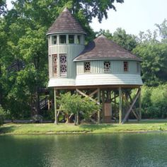 Beautiful fairy tale house on stilts near water.   Fully landscaped.  A real dream home!