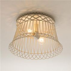 Vintage Wire Basket as Ceiling Light Surround. Must keep an eye out for something similar.