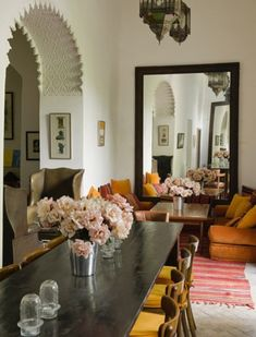 Moroccan inspired interior: Placement of prints and artwork, colour story, floral arrangement, intricate archway, and that huge mirror to reflect it all.