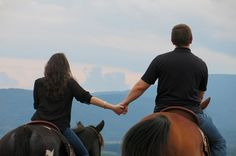 This horseback proposal photo is amazing, as is this proposal story