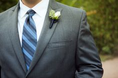Classic, timeless mens attire, accented with a cream rose.
