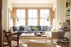 use a blanket or throw to cover up a sofa instead of reupholstering
