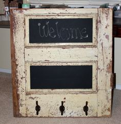 Old wood door cut in half..add some chalk board paint and some hooks...Love this..:)