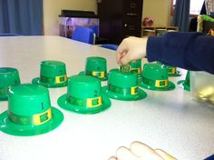 Counting GOLD!  I purchased these little Leprechaun Hats at the DollarStore along with Gold Coins. Slit an opening in the top of the hat and placed a number sticker on the front of each hat. Drop the correct amount in each hat! Lucky Leprechaun!