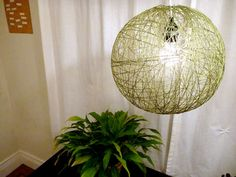 How To: Make a String Pendant Lamp. - fabric stiffener  - balloon  - crochet thread or cotton yarn  - rubber gloves  - newspaper  - lamp cord
