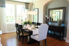 Dining Room Love -- dual drum light fixtures, varied chairs