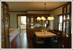Quarter sawn oak wainscoting, beautiful trim work, and built-ins with beveled glass kitchen nook.