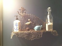 Cute shelf decor for a nautical bathroom! Make sure you put a real message in the bottle. ;)