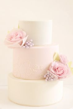 simple pink and white wedding cake; the part that i like is the simple, modern floral piping on the pink layer