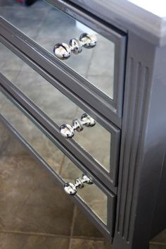 Mirrored drawer fronts.