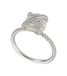 Diamond in the Rough Embrace Ring featuring a 3.62ct rough diamond accented with 0.39cts of micro pavé diamonds in platinum. http://ow.ly/adPyv