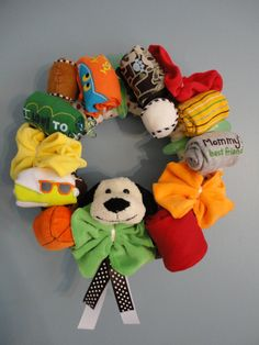 Baby gift wreaths...awesome idea, and what a way to combine handcrafted products!  Wonder how well it could work out for a bridal thing?