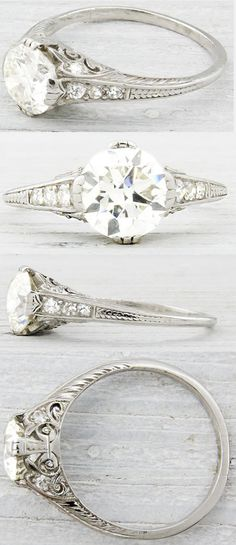 Art Deco engagement ring, circa 1930. Embellished with delicate engraving and sparkling side stones, this ring is centered by a 1.20 carat EGL certified old European cut diamond with K-L color and VS2 clarity. Via Diamonds in the Library.