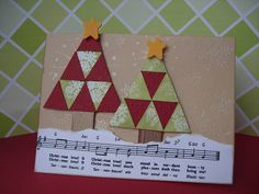 handmade Christmas card: Oh Christmas Tree Patchwork ... two triangle patch quilt trees ... luv all of the embossed snowflakes on the kraft background ... band of torn sheet music as the snowy ground ... wonderful card!!