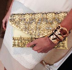 Valentino clutch via Neiman Marcus Instagram