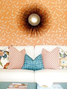 Designer Caitlyn Wilson paired floral wallpaper in a creamy orange hue with red-orange and blue pillows. (http://www.hgtv.com/color/tangerine-tango-decorate-with-pantones-2012-color-of-the-year/pictures/page-4.html?soc=Pinterest)