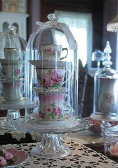 Tea cup stack under glass