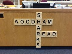 Big scrabble letter for signage at the circulation desk! Pinner purchased letters at Really Big Stuff store.