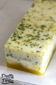 A loaf of Meyer Lemon and Herbs Honey Soap.
