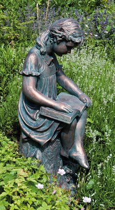 garden statues.   This one is particularly sweet.  Nothing better than being outside on a beautiful than having a wonderful book to read there. I want for my garden!!!