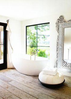 Primitive wood floor w/ luxury soaking tub and Moorish accents