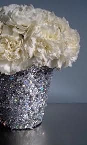 Glittery julep cup filled with affordable white carnations